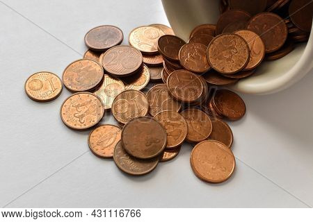 Euro Cent Coins Spilling Out Of A Jar.