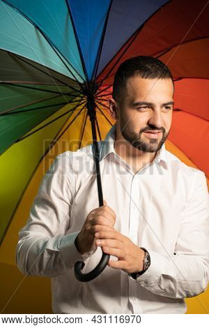 Supporting Minorities Straight Handsome Guy With A Rainbow Umbrella Behind His Back. Healthy Fashion