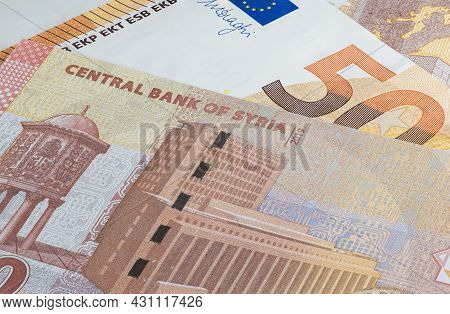 Syrian Pound Or Lira Together With Euro Banknote. Money Of The Arabic Country. Close Up Detailed Mon