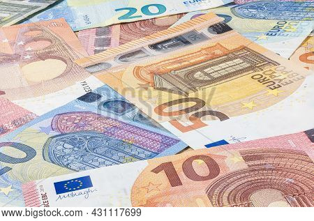 Pile Of Euro Banknote. Many Euro Bills Lie On Top Of Each Other. Bunch Of Money Of The European Unio