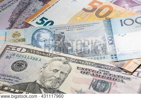 Close Up To 100 Gourde Of The Republic Of Haiti Between 50 Us Dollar And 50 Euro Banknotes. One Hund