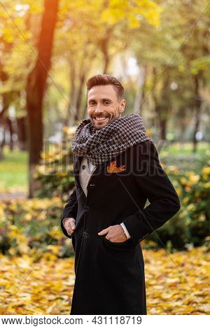 Handsome Man Wearing Dark Blue Coat And Scarf Waiting On His Date Smile On Camera. Young Freelancer