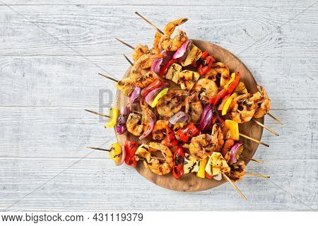 Grilled Shrimp Kabobs With Charred Red Onion, Sweet Pepper And Pineapple On A Wooden Board, Flat Lay