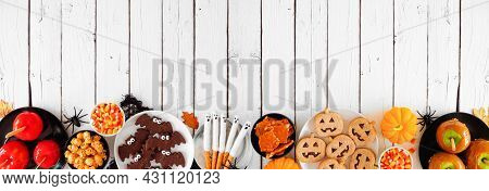 Traditional Halloween Treat Bottom Border Over A White Wood Banner Background With Copy Space. Top V