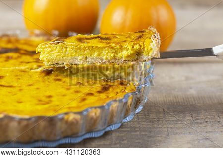 Fresh Pumpkin Pie. Pie On A Brown Wooden Table. Copy Space