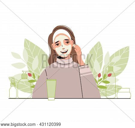 Woman Takes Care Of Her Face: She Applies A Cosmetic Mask. Collection Of Body And Skin Care Products