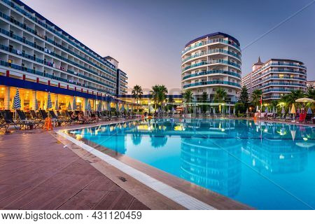 Turker, Turkey - July 19, 2021: Pool area of the Eftalia Marin hotel in Alanya province at dusk, Turkey. The complex of several Eftalia hotels is located on the Turkish Riviera.