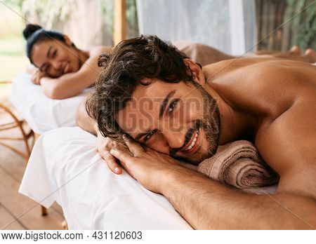 Beautiful Couple Getting A Back Massage On Bali Resort, Romantic Weekend And Relax. Couple Massage A