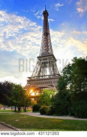 Eiffel Tower, Iconic Paris Landmark With Setting Sun And Vibrant Blue Summer Skies, France