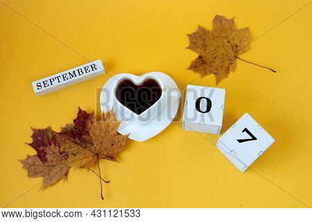 Calendar For September 7 : The Name Of The Month In English, Cubes With The Numbers 0 And 7,a White