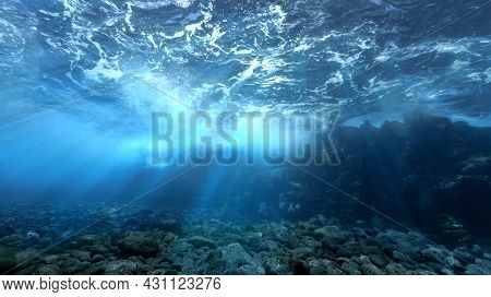 Beautiful And Magic Underwater Photo Of Rays Of Light Breaking Through The Surface And The Waves. Fr