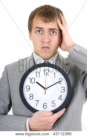 Shoked Businessman Holding A Clock