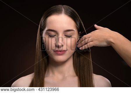 Hairstylist Working On A Fashion Model Beautiful Face Isolated On Black Background. Beautiful Model