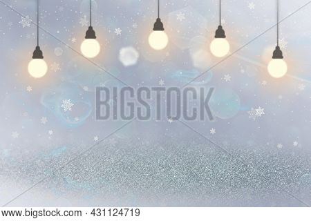 Beautiful Sparkling Abstract Background Glitter Lights With Light Bulbs And Falling Snow Flakes Fly