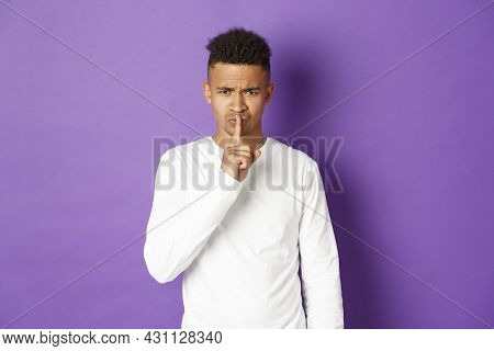 Image Of Angry African-american Man Hushing At You, Press Finger Over Lips, Showing Taboo Sign, Stan