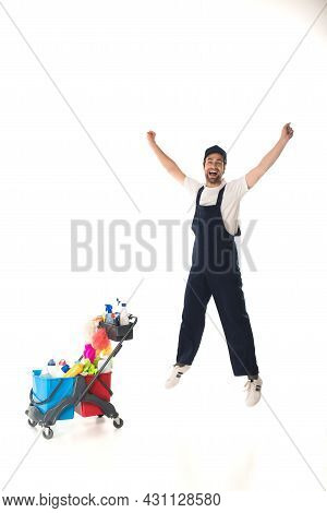 Excited Cleaner Jumping Near Cart With Deterrents On White Background