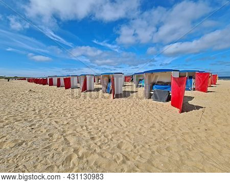 Beach houses on the beach in Katwijk aan Zee on a nice summer day in the Netherlands