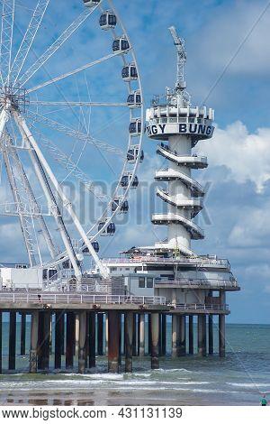 10 August 15, 2021, Scheveningen, The Hague , Netherlands, Amusement Park, With Ferries Wheel And Bu