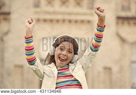 Happy Energetic Girl Listening Music Modern Headphones, Dancing Child Concept
