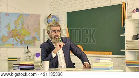 Teacher Bearded Man Chalkboard Background. Teacher Work. Lecturer In Classroom. College High School.