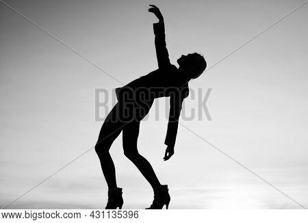 Female Silhouette On Sunset. Woman Dance In Dark. Dark Figure Shape. Girl Dancing In Dusk