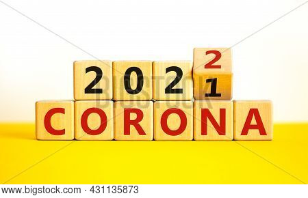 Symbol Of Covid-19 Pandemic In 2022. Turned A Wooden Cube And Changed Words 'corona 2021' To 'corona