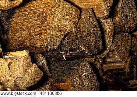 A Large Rustic Pile Of Dry Firewood. Old Firewood. Background.