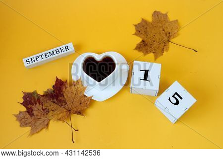 Calendar For September 15 : The Name Of The Month In English, Cubes With The Number 15,a White Heart