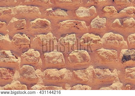 Background Of Retro Sandstone Brickwork. The Wall At The Excavations Of Historical Monuments. Textur
