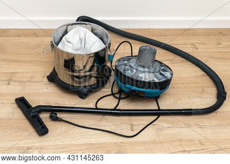 Opened Construction Vacuum Cleaner On The Floor