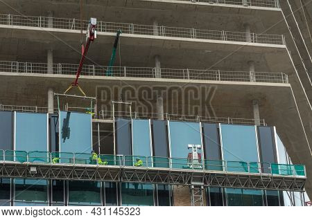 Workers Inserting Windows On A High-rise Building, Frankfurt Am Main, Germany