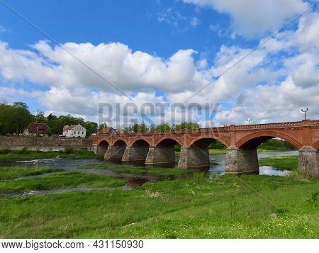 Old Red Brick Bridge Over Venta River In Kuldiga - Unesco World Heritage Site, Kurzeme Region, Latvi