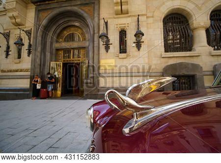 Bucharest, Romania - August 19, 2021: A Red Matador Maroon Iridescent 1951 Packard 300 Car Is Parked