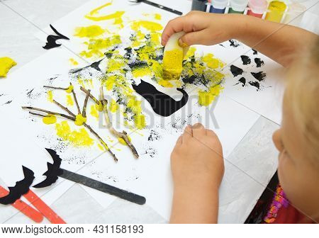 Child Making Card For The Holiday  Halloween. Funny Crafts From Paper, Natural Tree Twigs And Painti