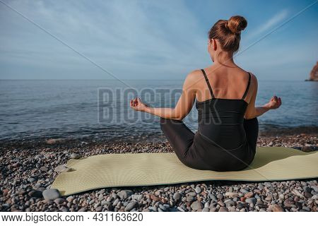 Young Woman With Long Hair, Fitness Instructor In Black Sportswear Leggings And Tops, Stretching Bef