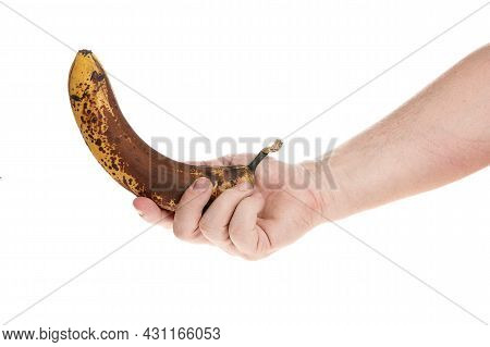 Hand Holds A Ripe Banana On A White Background, Template For Designers