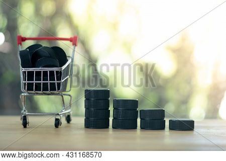 Cart With Black Plastic Caps And Black Plastic Caps Like A Graph On Table Ready To Be Recycled. Conc