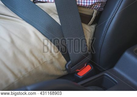 Man Putting On His Seat Belt In His Car. Safety Drive Concept.