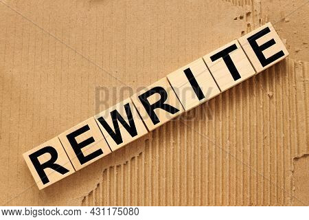 Rewrite, Wooden Blocks On Craft Background From Torn Paper