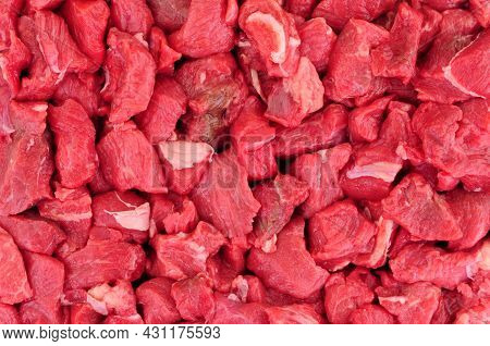 Fresh Raw Cubes Of Lean Beef Steak Red Meat Background