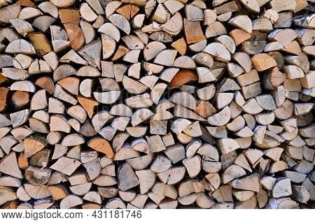 Preparation Of Firewood For Winter. A Woodpile Made Of Birch Wood. Copy Space. Firewood Background