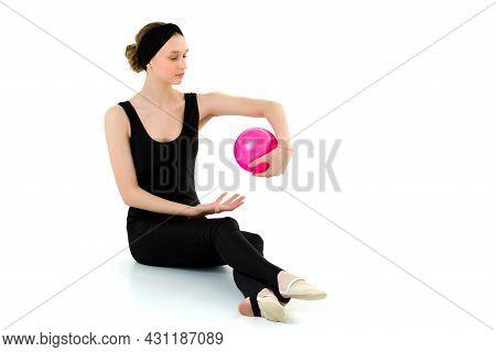 Teen Girl Doing Rhythmic Gymnastics With Pink Ball. Attractive Sports Girl Wearing Black Leotard Doi