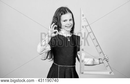 Pupil Girl With Big Ruler. School Student Learning Geometry. Small Girl Back To School. Stem School