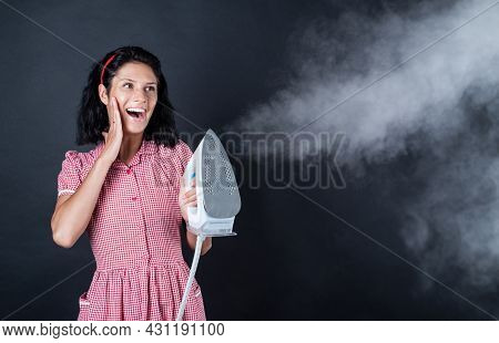 Housekeeping. Pinup Girl Use Steaming Iron. Home Appliance. Housekeeper Woman Ironing. Happy And Smi