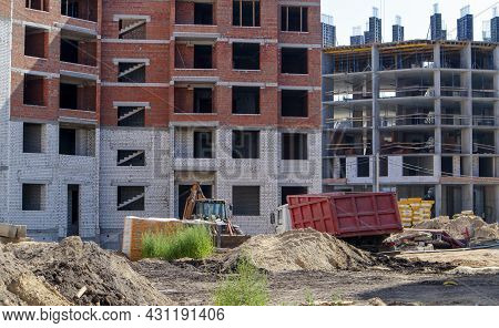 Large Construction Site. The Process Of Capital Construction Of A High-rise Residential Complex. Con