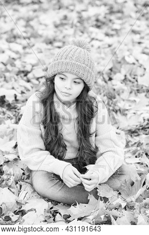 No Rush. Beauty Of Fall Nature. Happy Kid Wear Knitted Sweater And Hat. Teen Girl Relax Among Fallen