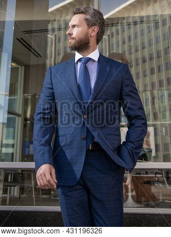 Business Success. Successful Man In Businesslike Suit. Manager Executive Outside The Office.