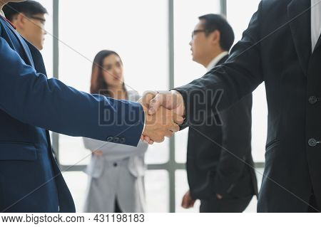 Asian Business People Team Shaking Hands For Dealing Sucess. Team Of Businesspeople Shaking Hands, F