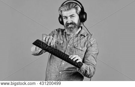 Graphics Settings Pushed To Limit. Play Computer Games. Man Bearded Hipster Gamer Headphones And Key