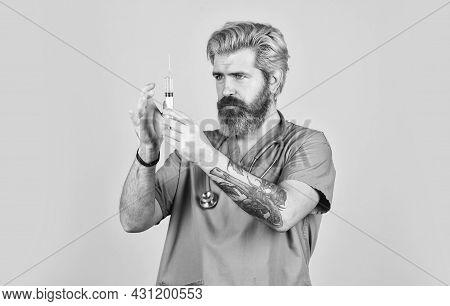 Antidote. Man Nurse With Coronavirus Vaccine In Syringe. Flu Vaccine. Bearded Doctor Wear Uniform Us